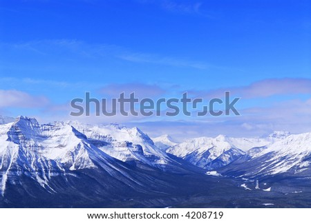 Snowy mountain ridges at Lake Louise in Canadian Rocky mountains - stock photo