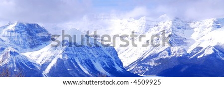 Snowy mountain ridges in Canadian Rockies, panoramic view - stock photo