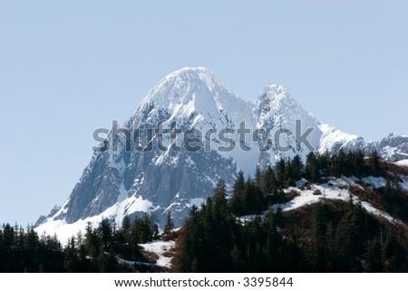 Snowy mountain tops in Alaska - stock photo