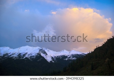 Snowy mountains and pink clouds at sunset in the Parvati Valley, Himachal, India - stock photo