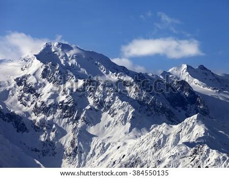 Snowy mountains at nice sunny day. Caucasus Mountains. Georgia, region Svaneti. - stock photo