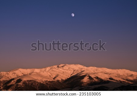snowy mountains at sunset - stock photo