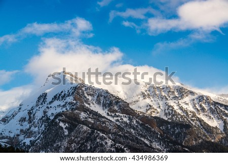 Snowy mountains during winter in the Aragon Valley pyrenees, Aragon, Spain.