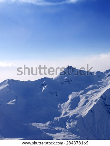 Snowy mountains in mist at early morning. Caucasus Mountains, Georgia, ski resort Gudauri. - stock photo