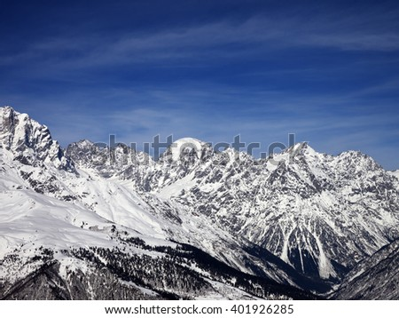 Snowy mountains in wind sunny day. Caucasus Mountains. Svaneti region of Georgia. - stock photo