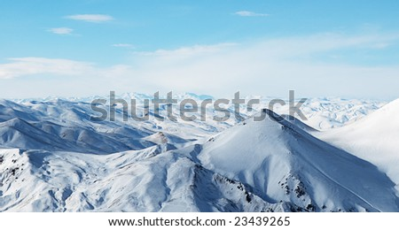 snowy mountains under beautiful sky with clouds