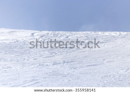snowy mountainside outdoors in winter - stock photo