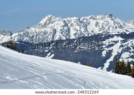 Snowy off-piste slope in the Alps - stock photo