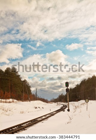 snowy old railway in winter near forest - stock photo