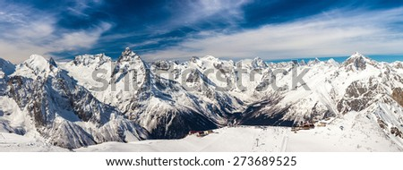 Snowy peaks against the blue sky - stock photo