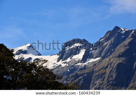 Snowy Peaks and Forest, Routeburn Track, New Zealand - stock photo