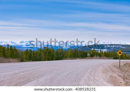 Snowy peaks of Northern Rockies landscape, Alaska Highway at Steamboat, British Columbia, Canada - stock photo