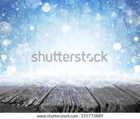 Snowy Plank With Wintery Forest Background  - stock photo