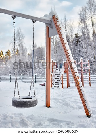 Snowy playground in December, frost and cold weather - stock photo