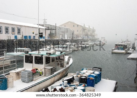 Snowy Portland, Maine harbor with lobster boats during a blizzard - stock photo