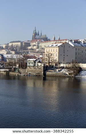 Snowy Prague Lesser Town with Gothic Castle in the sunny Day, Czech republic