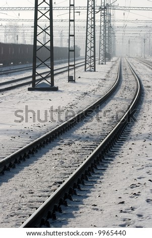 Snowy railway tracks in winter - stock photo