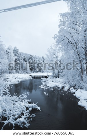 Snowy river in lapland