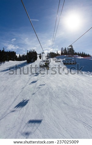 Snowy ski lifts in Whistler, Canada - stock photo