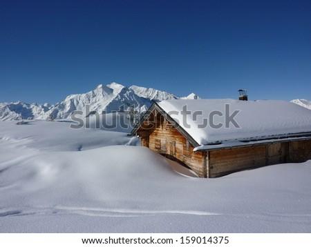 snowy ski lodge in the Alps - stock photo