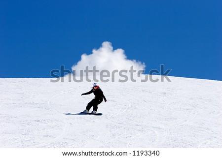 Snowy ski slopes of Pradollano ski resort in the Sierra Nevada mountains in Spain with woman snowboarding - stock photo
