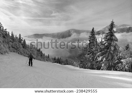Snowy slope in the mountains, artistic version in black and white - stock photo