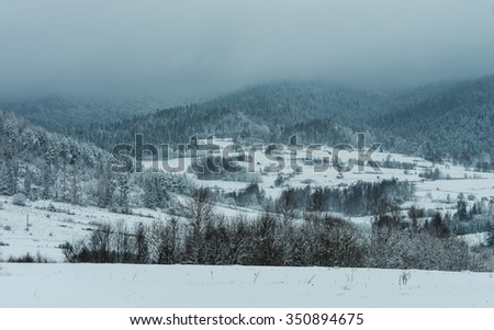 Snowy slopes of cloudy Gorce mountains in Little Poland - stock photo