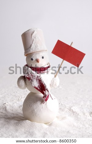 Snowy snowman with blank red board - stock photo