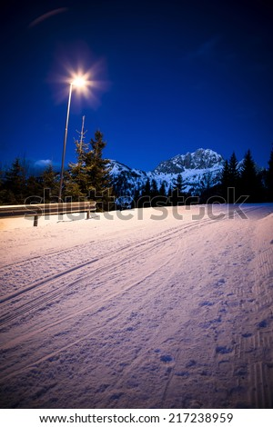 Snowy street at night - stock photo