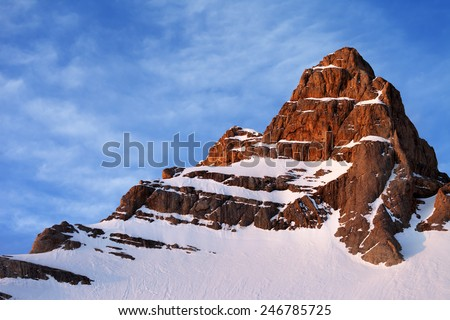 Snowy sunlight rocks at sunrise. Turkey, Central Taurus Mountains, Aladaglar (Anti-Taurus) - stock photo