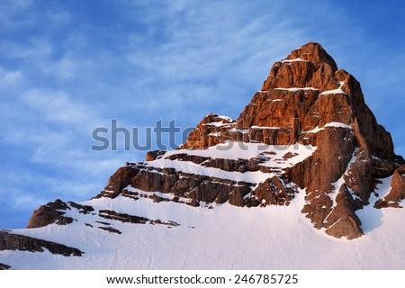 Snowy sunlight rocks at sunrise. Turkey, Central Taurus Mountains, Aladaglar (Anti-Taurus) - stock photo