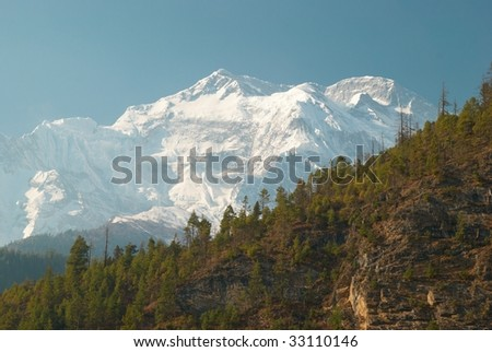 Snowy Tibetan mountains, view from Annapurna trek - stock photo