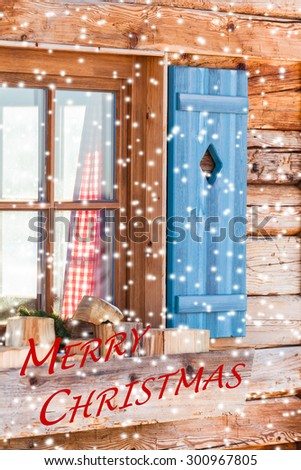 Snowy window detail of a bavarian alps wooden mountain hut with textual holiday message/Window of Bavarian Chalet in Winter - Merry Christmas - stock photo