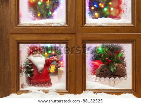 Snowy window with Christmas pudding and tree with twinkling fairy lights - stock photo