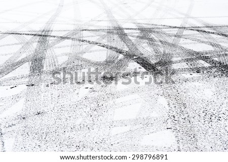 Snowy winter city road with tire trace. - stock photo