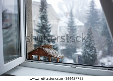 Snowy winter day behind the window - stock photo