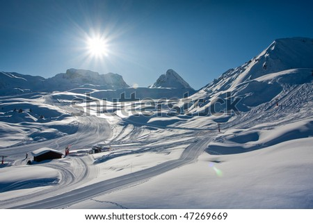 Snowy winter in mountains. European Alps - stock photo