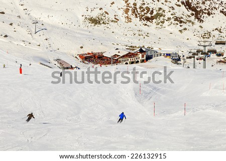 Snowy winter landscape of a ski resort in the Alps - stock photo