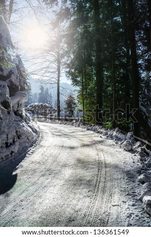 Snowy winter road - stock photo