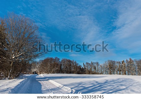 Snowy winter road - stock photo