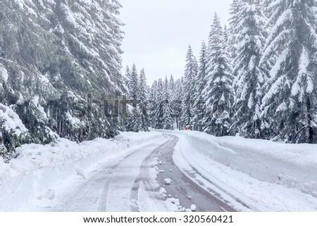 Snowy winter road in Julian Alps-Slovenia - stock photo