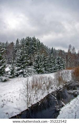 snowy winter scene by river - stock photo