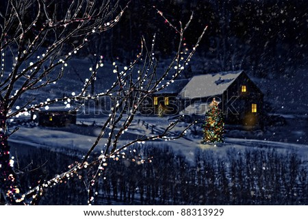 Snowy winter scene of a cabin in distance at night - stock photo