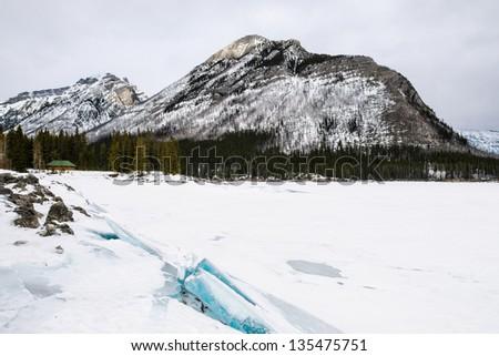 Snowy winter scenery in the Canadian Rocky Mountains - Lake Minnewanka Banff National Park, Alberta Canada - stock photo