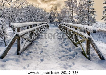 Snowy, wooden bridge in a winter day. Stare Juchy, Poland.