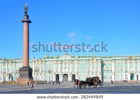 Snt. Peterburg, Russia, September, 27,2014. Russian scene: People in the wagon, drawn by two brown horse ride  Palace square near the Alexander column