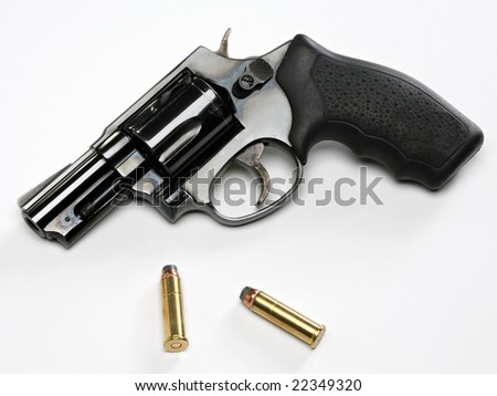 snub-nose revolver with bullets on white background - stock photo