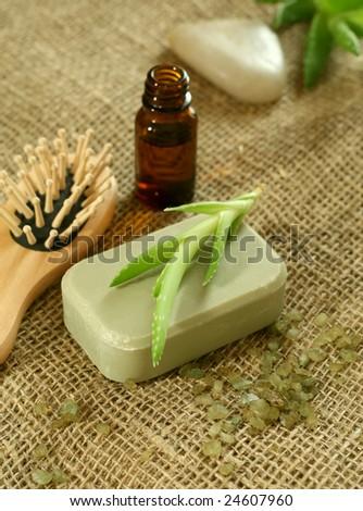 Soap, aloe vera and a bottle with oil aloe vera - stock photo