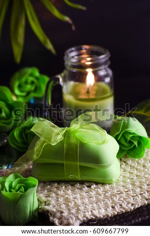 Soap and a variety of accessories for a spa on a black background