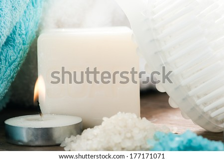 Soap and beige blue spa setting  - stock photo